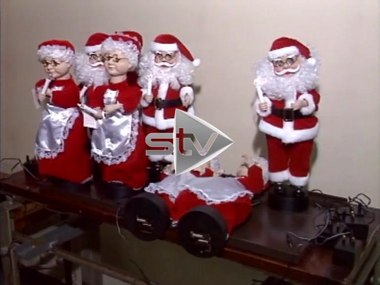 Defective Dancing Santas
